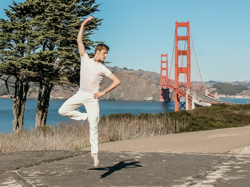 Ian jumping with the Golden Gate Bridge in the background. Photo by Maggie Carey