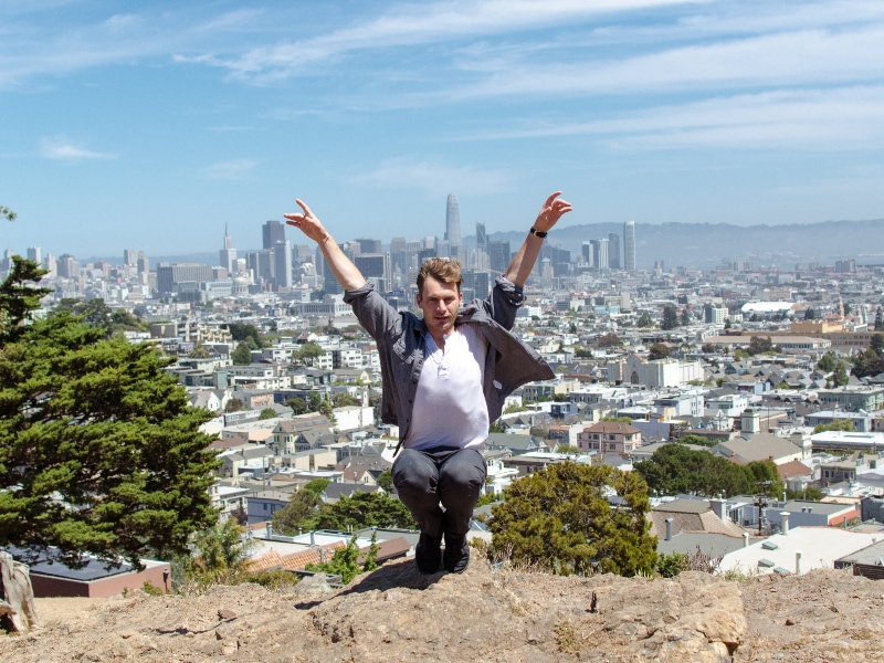 John in a cool shape with San Francisco in the background.