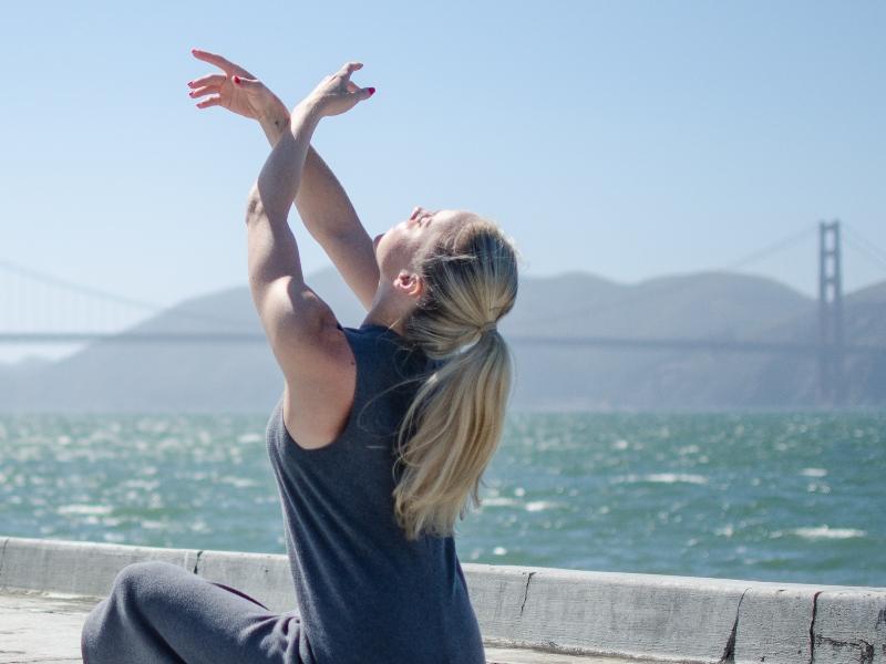 Lauren sitting in front of the ocean.