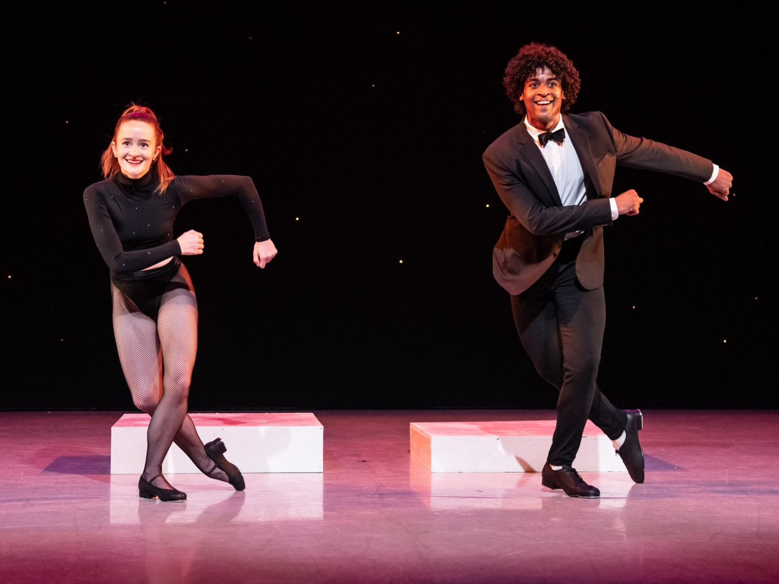Maggie and Ricky dancing together in tap shoes