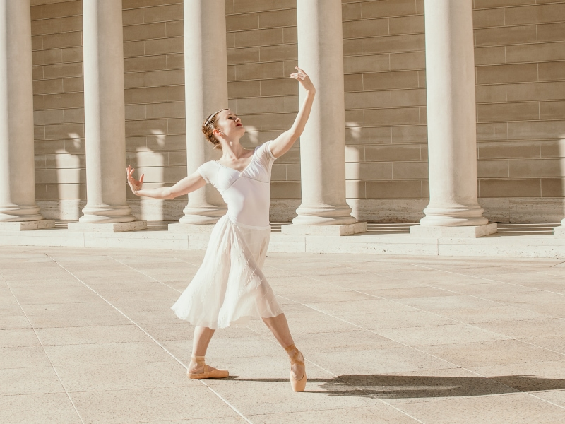 Maggie dancing in front of the Legion of Honor.