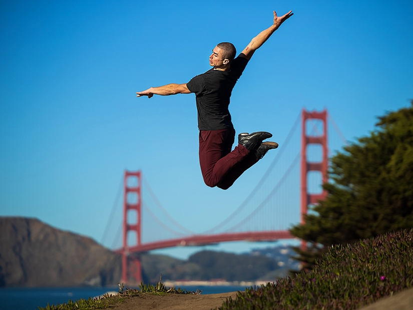 Max jumping with Golden Gate Bridge in the background.