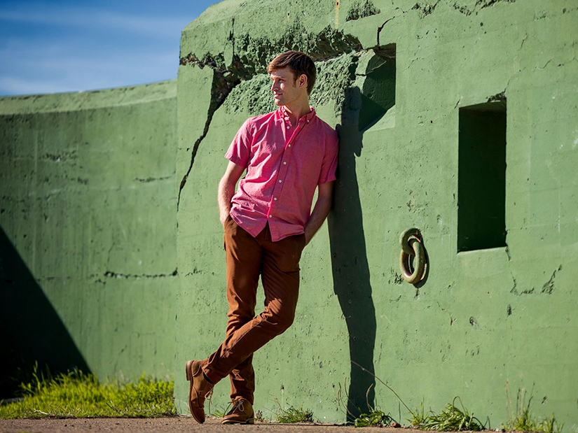 Ian leaning against a wall. Photo by Chris Hardy