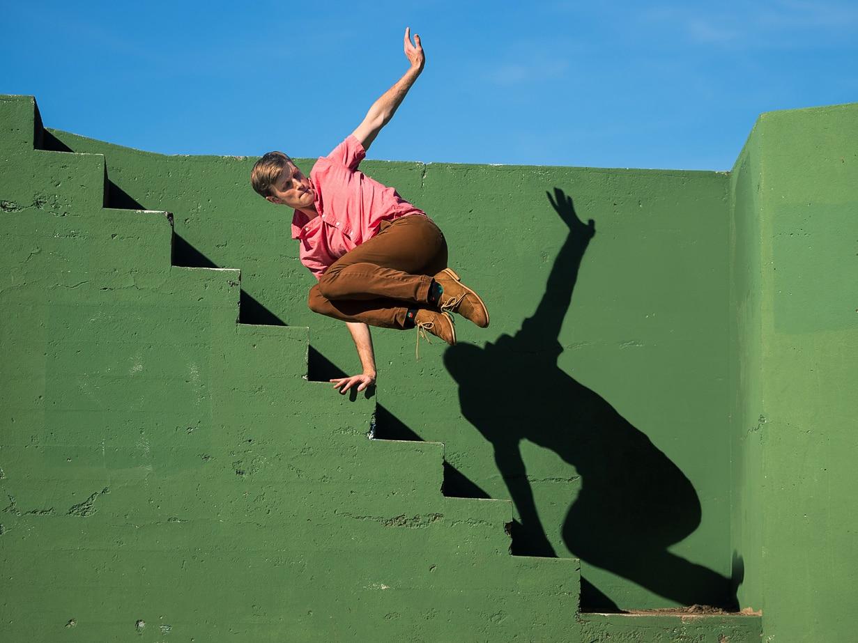 Ian Buchanan jumping off stairs. Photo by Chris Hardy
