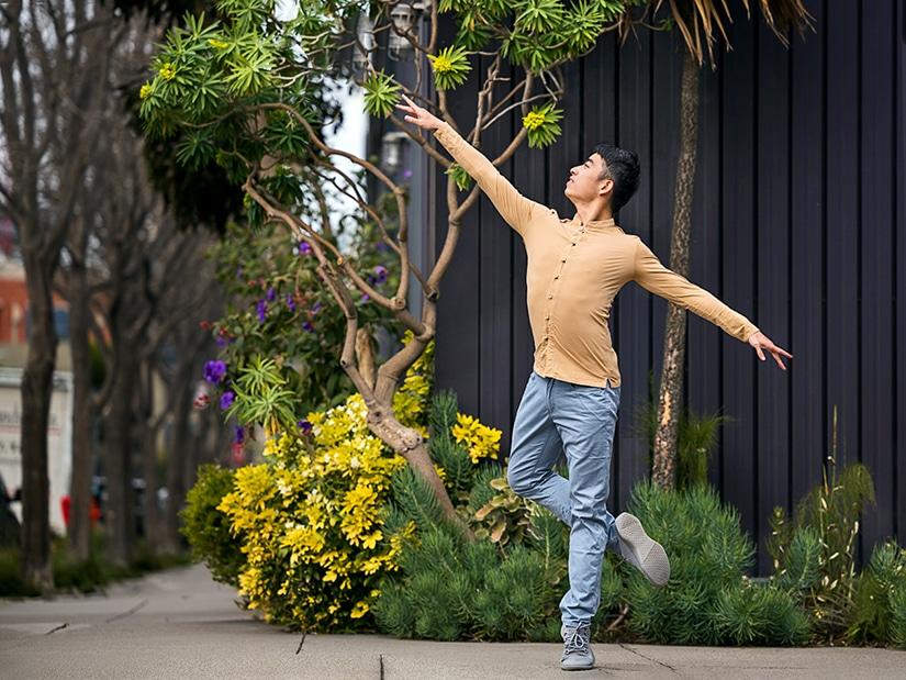 Meng dancing in front of cute garden.