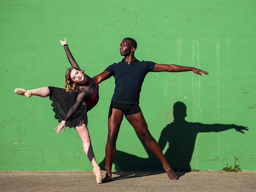 Brandon Alexander partnering with Cassidy Isaacson in front of striking green wall, photo by Chris Hardy