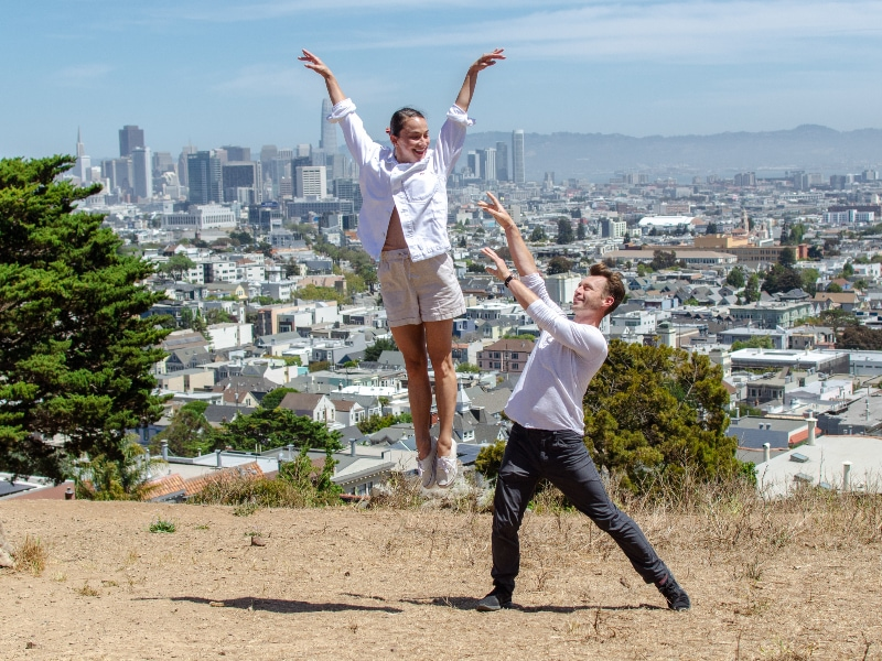 Terez and John dancing together with San Francisco in the background.