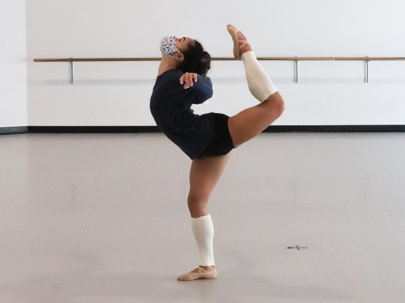 Tess showing off her flexibility to the back in the studio.